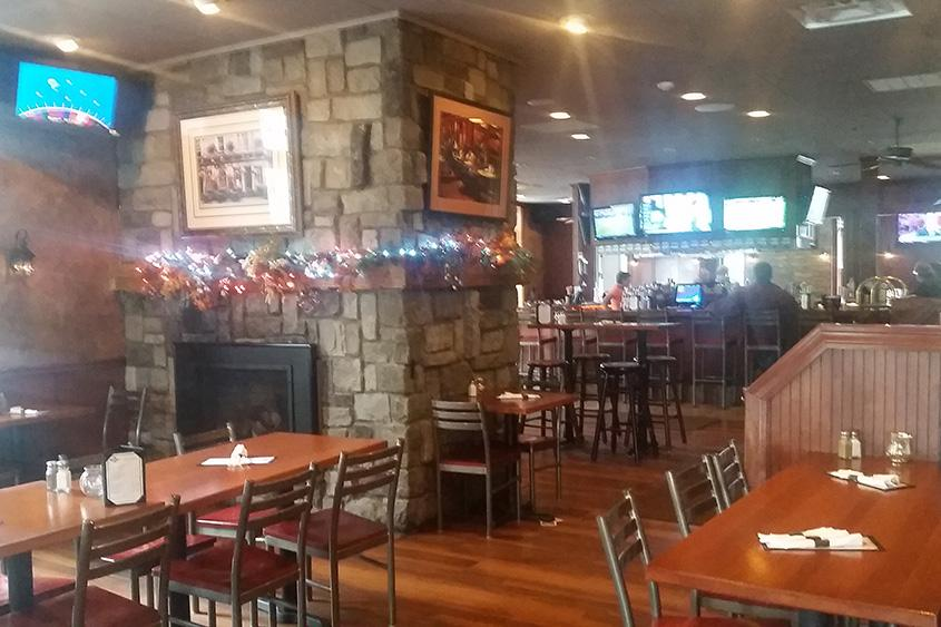 The interior at Bentley's Tavern, with plenty of wood paneling, is broken up into sections.